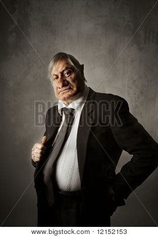 Portrait of nasty and bossy businessman
