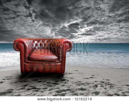 empty leather armchair on the beach