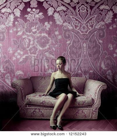 Beautiful woman seated on a sofa