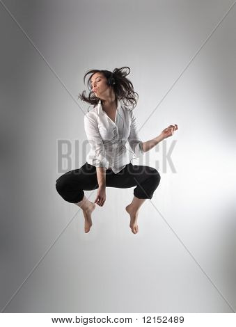 teen listening music and jumping