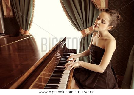 beautiful woman playing piano in a luxury interior