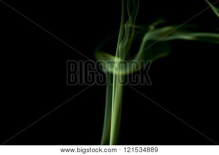 Green Colored Smoke On A Black.