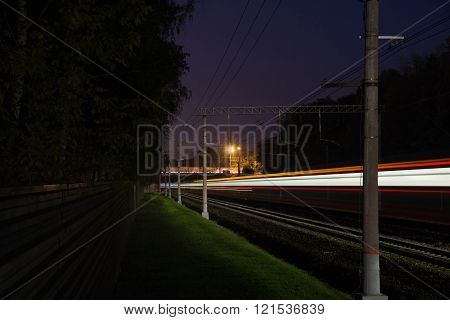 Railroad Tracks In The Evening
