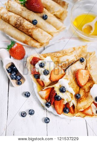 Pancakes With Whipped Cream And Strawberries