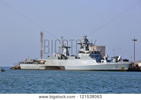 GULF OF ADEN, DJIBOUTI â?? FEBRUARY 08, 2016: EU WARSHIP F-262, German multipurpose corvette, (Braunschweig-class) in the port of Djibouti