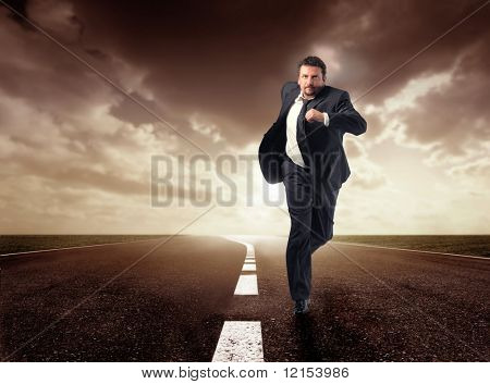 business man running isolated on the road