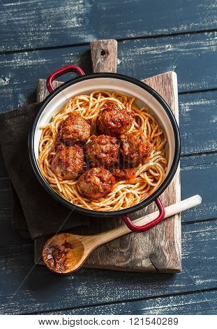 Spaghetti And Meatballs In Tomato Sauce On Wooden Rustic Board. Delicious Lunch