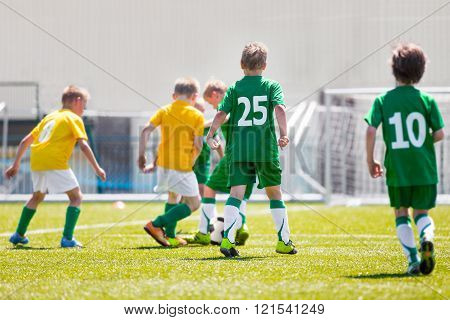 Young Boys Children In Uniforms Playing Youth Soccer Football Game Tournament