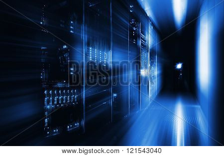 server room in the dark, with bright colored lights motion