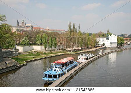 Prague, Czech Republic - April 28, 2010: Ships On The River Vltava With Prague Castle In He Backgrou