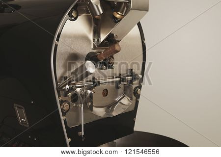 Best professional coffee roasting machine filled with beans and ready to work Side view closeup brow