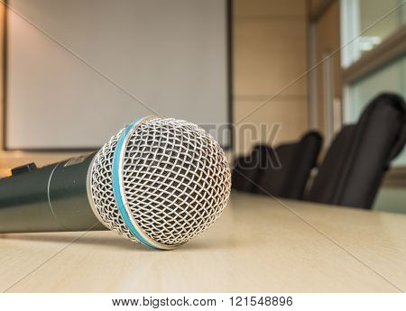 Microphone On Wood Desk In Meeting Room Under Window Light