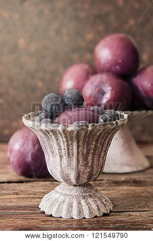 plum with blueberries ripe berries to diet