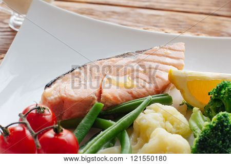 Seafood in lent. Salmon steak and vegetables.