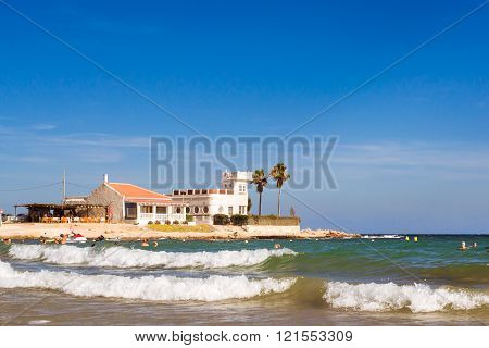 Sunny Mediterranean Beach, Tourists Relax On Wave, Cala Del Palangre, Torrevieja, Spain