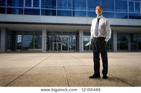 asian businessman in front of his corporate