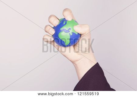 Hand Compressing Planet Earth. European Continent.