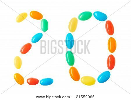 20 number made of multicolored candies isolated on white