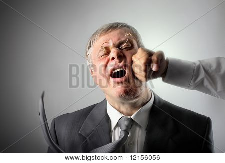 senior businessman hit on the face by punch poster