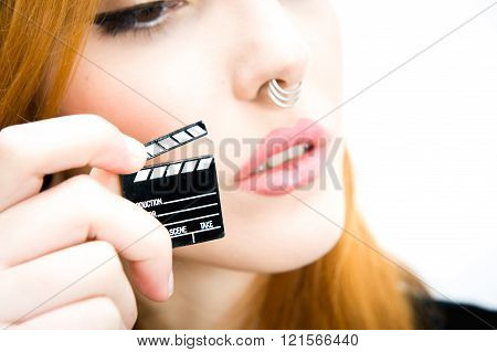 Detail Of Little Movie Clapper Board And Redhead Woman Face