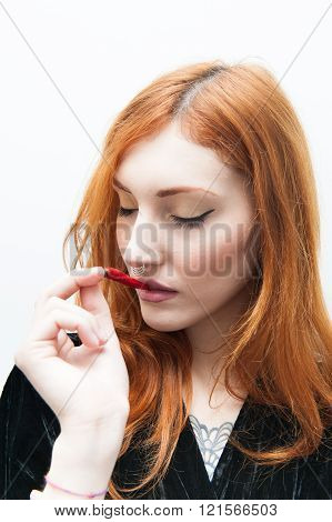 Young Redhead Woman Portrait With Red Hot Chili Pepper