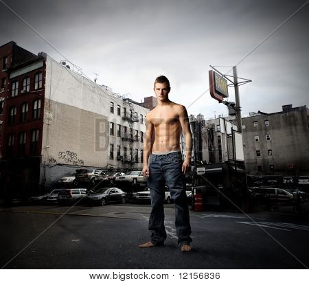 muscular guy in a city street