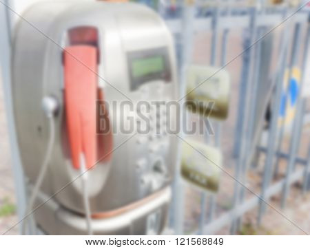 Blurred Old Public Telephone Coin (payphone)