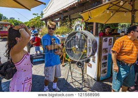 Woman Cools Down At A Ventilator In The Heat Of The Day In Los Angeles