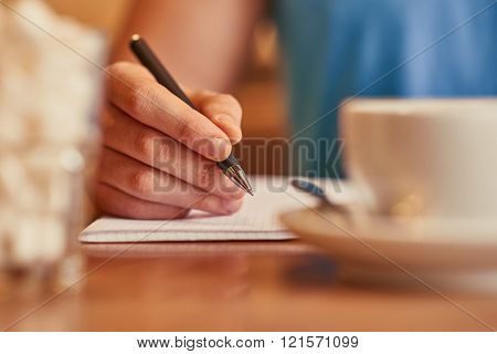Pleasant man writing