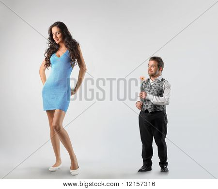 dwarf paying court to tall woman