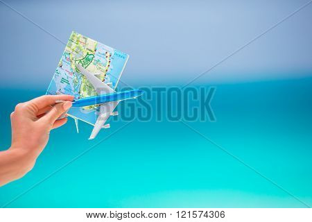 Map and toy airplane background the turquoise sea