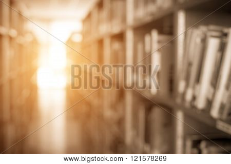 blur image of the library or Book shelf Knowledge and Research in Education and sun light