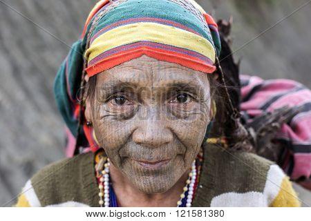 Chin tribe tattooed faced woman (Yin Duu).