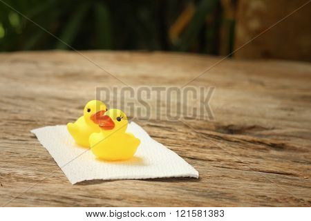 Yellow rubber duck on background of wooden.