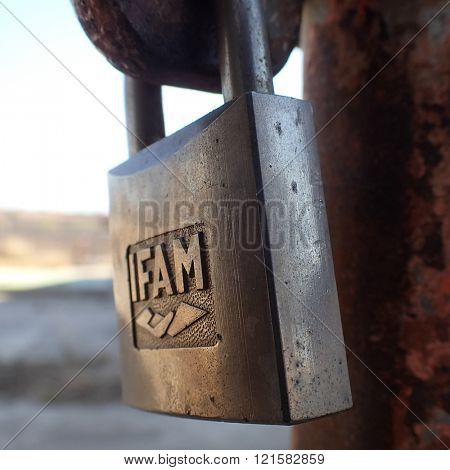 VALENCIA, SPAIN - MARCH 12, 2016: A close-up of an IFAM padlock. IFAM is a leading Spanish manufacturer of padlocks, locks and anti-theft devices for motorcycles and bicycles.