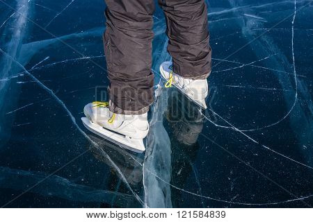 Woman Skating On The Frozen Lake Baikal