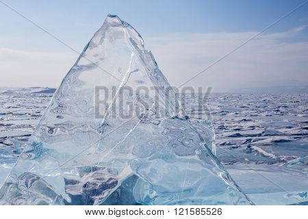A Transparent Triangle Hummock On The Surface Of The Blue Frozen Lake Baikal. Horizon. Blue Transpar