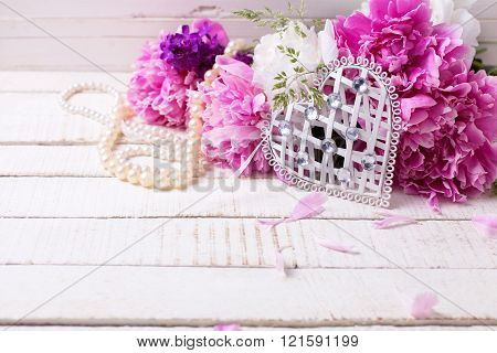White Heart And Fresh Pink And White Peonies Flowers   On White Painted Wooden Planks.
