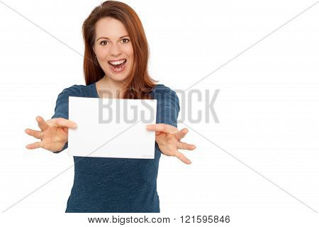 Young smiling woman holding a blank white paper in her hands