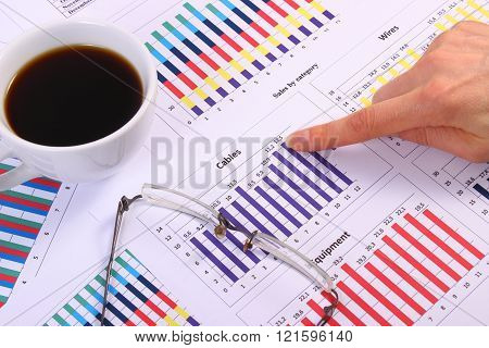 Finger Showing Financial Graph, Glasses And Cup Of Coffee, Business Concept