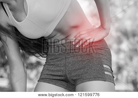Woman in sport bra having a hip pain / Rheumatoid (In Black and White Tone with Red Mark)