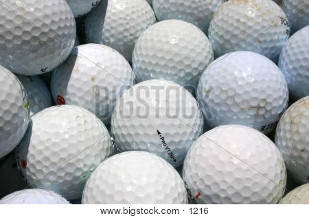 Bunch of Golf Balls, some clean, some a little dirty poster