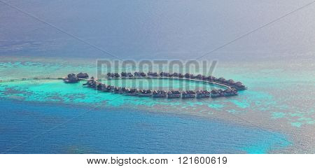 Aerial view on Maldives resort, Raa atol