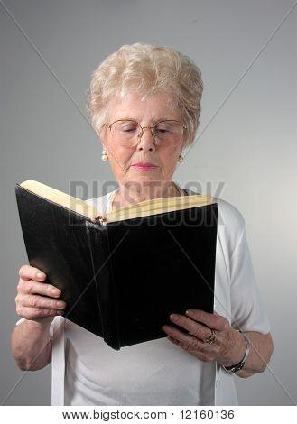 Senior woman reading a book