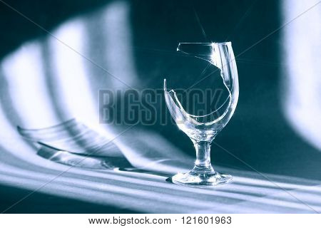Broken Wineglass On Dark