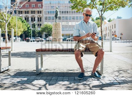 Senior Tourist In The City Using Mobile Phone