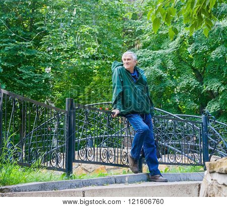 Smiling Senior Man In A Park