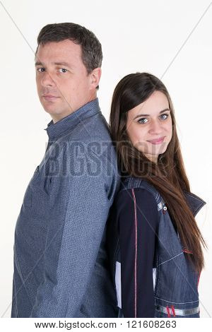 Man And His Teenage Daughter Back To Back