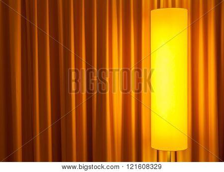 floor lamp ahead curtain on the left
