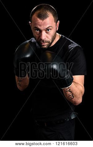 Portrait Of Male Athlete Boxer Man Looking Aggressive With Boxing Gloves On.